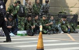 Over 1,000 protesters in military uniforms march outside Chinese defense ministry