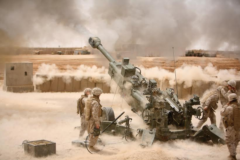 Marines from Battery M, 3rd Battalion, 11th Marine Regiment fire an M777 howitzer during a training exercise aboard Camp Fallujah, Iraq