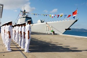 Navy officers attend a flag-presenting ceremony as the Hefei, the third 052D Type 052D guided missile destroyer commissioned by the PLA Navy is delivered to the South Sea Fleet on December 12, 2015 in Sanya, Hainan Province of China. (Image Courtesy: Time)