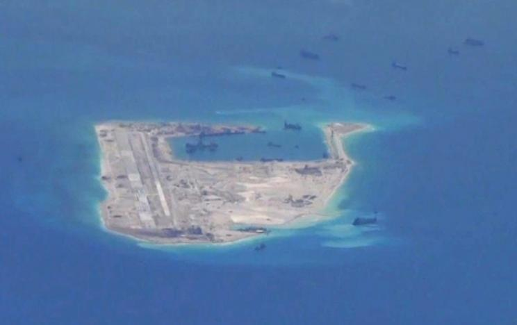 South China Sea: Chinese Military Tells US Ship 10 Times To Turn Around