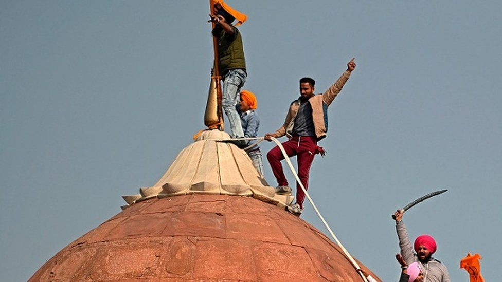 India protest: Farmers breach Delhi's Red Fort in huge tractor rally
